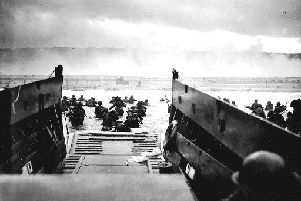 Ready for the fight...a D-Day landing craft reaches the beaches in Normandy on June 6, 1944.