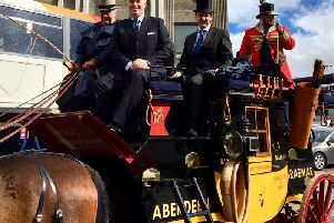 Gordon MP Colin Clark sits on the horse drawn carriage with Mark Whitelocks, MD of Stagecoach North Scotland