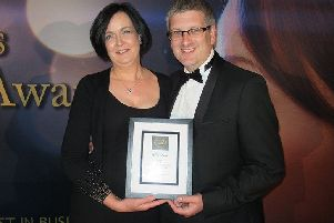 Business owners Gary Jamieson and Sheila Taylor with the award