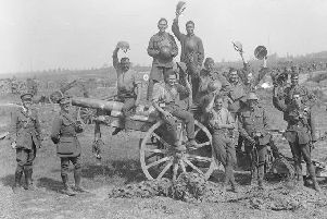 Following the capture of Grevillers by the New Zealand Division, Men of the Royal Garrison Artillery pose beside one of the 4.2 inch guns of a captured battery at Grevillers, 25 August 1918. Note the camouflage netting on the ground, which was designed to prevent the guns from being spotted from the air. � IWM (Q 11243)