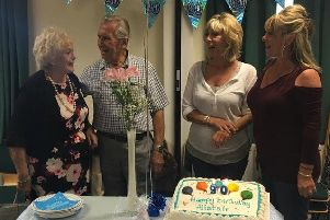 Alistair Smith is pictured with family at his 90th birthday celebration.