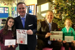 Colin Clark MP with Christmas card design winners Vikki Scott (Auchterellon) and Layla McGunnigle (Uryside)
