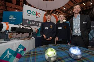 Meldrum Academy pupils James Padmos and Max Walker with David Wavell from The ORCA Hub