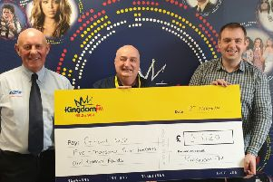Kingdom FM 'Word is Out' winner Grant Muir (centre) with Mark Lambert; and Dave Connor