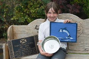 At the Catterline School end of year assembly last Thursday, the first winner of the Joan Eardley Memorial Quaich was P4 pupil Belle McMurtrie, from Barras. Belle is pictured with her winning artwork and the replica of the Historic Scotland plaque which was presented to the school by local heritage pioneer Dave Ramsay.