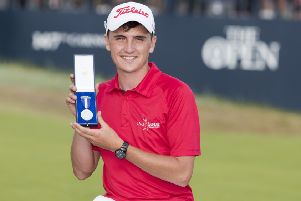 22/07/18 THE 147TH OPEN FINAL DAY ' CARNOUSTIE ' Scotland's Sam Locke receives the silver medal award as the leading amateur.
