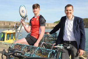 Willie Tulloch from STRIVE (right) and Stonehaven rugby player Zander Begg.