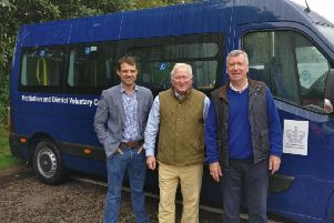 Pictured (from left) are  Andrew Bowie, Councillor Colin Pike and ambulance chairman Colin Stratton.