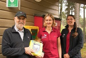 Kenneth Cooper is pictured with volunteer rangers Keira Macfarland and Leo Hunt.