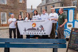 Stunning Stonehaven was launched by the town's Olympic curler Jackie Lockhart, centre, pictured with committee members. Photo: Martin Sim