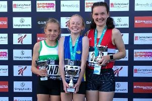 Gala Harrier Isla Paterson, left, on the podium at the Great North Run.
