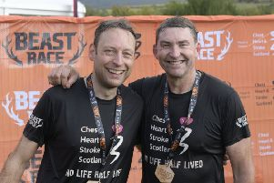Liam Kerr, left, with Brian Whittle after the Beast race
