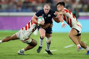 Stuart Hogg is stopped in his tracks by the Japan defence. Picture: Getty Images