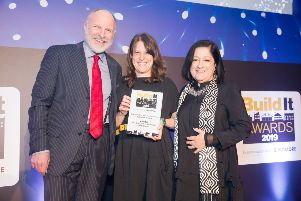 Tess Lavery (centre) receives her award from comedian Simon Evans, who hosted the evening, and Jane Duncan, past president of the Royal Institute of British Architects