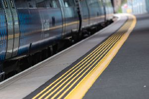The safety campaign encourages passengers to take care at stations, 'including staying behind the yellow lines when trains are moving.