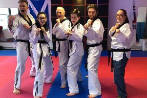 Members of the Dojang Martial Arts Tae Kwon Do Academy in Bishopbriggs celebrate their success