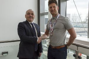 Kirkintilloch curler Ross Paterson is congratulated on his world championship medal by Cllr Billy Hendry, East Dunbartonshire Council Convener of Place, Neighbourhood and Community