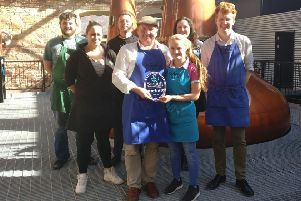 Staff at the Borders Distillery in Hawick celebrating their five-star VisitScotland rating.