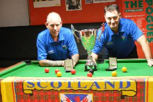 Scotland Masters team members Robert Hoey (left) and Hugh McBride with the European Championship trophy they won earlier this year.