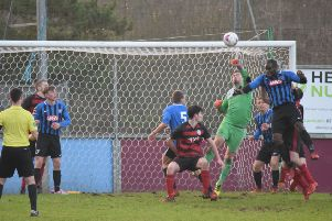 Christian Nade puts pressure on the Rob Roy defence during the draw with Troon