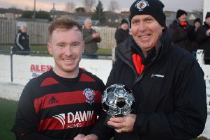 Rob Roy match winner Lee Gallacher receives the Supporters' Man of the Match trophy, donated by Roddy the Dog Walker, from sponsor John Lang.