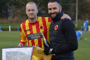 Kirk Forbes is congratulated by manager Gordon Moffat on his 100th appearance for Rossvale at Lanark. (pic by permission of HT Photography/@dibsy_)