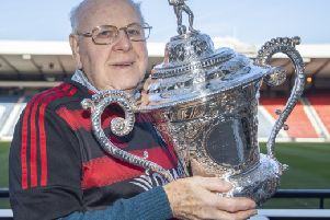 Back in safe hands...Ian Dyer was reunited with the junior cup he last lifted back in 1962 when he was captain of the successful '11961-62 Kirkintilloch Rob Roy FC team.''(Pic: Graeme Hunter)