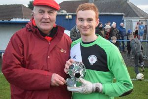 Rob Roy keeper Craig Gordon receives his man of the match award from sponsor Malcolm Campbell