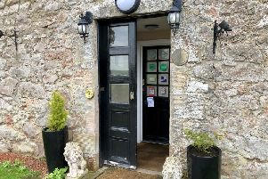 The one open door our reporter found at Shieldhill Castle Hotel behind which lay bundles of unopened mail.