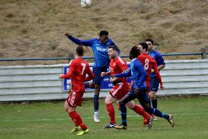 Royal Albert trialist Moses Njie heads the ball clear (Pic by Alwyn Johnston)