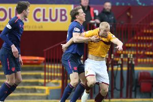 Curtis Main is grappled by Hearts defender Christophe Berra on Sunday (Pic by Ian McFadyen)