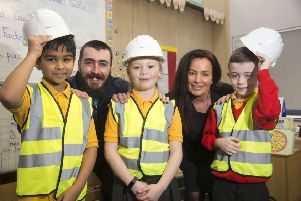 Children are learning about safety on building sites