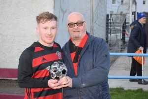 Lee Gallacher receives the Supporters' Man of the Match trophy, donated by Roddy the Dog Walker, from sponsor John McKean