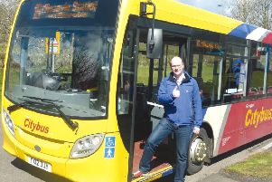 Photo by Emma Mitchell 15.12.15 Duncan Cumming next to the bus stop at Hillfoot station.