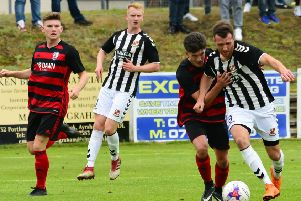 Action from Rob Roy's West of Scotland Cup final with Beith (pic by Stephen Kerr)