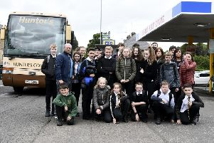 Parents and children who use the bus from Eskbank, pictured before the council's decision was dropped.