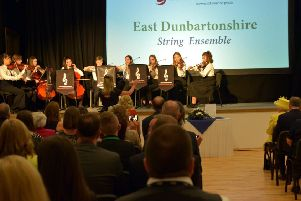 East Dunbartonshire Senior String Orchestra perform for the Queen during her visit to Greenfaulds High in Cumbernauld