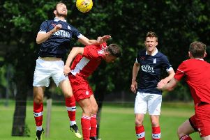 Gregor Buchanan outjumps former Bairn Kevin O'Hara during Falkirk's closed-doors friendly with Hamilton (pic: Michael Gillen)