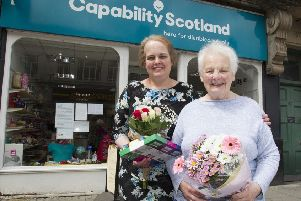 Donna Mackie and mum Fiona outside Hawick's now-closed Capability Scotland charity shop.