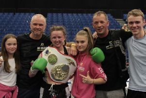 Rhona with family members and M-Mag coaches after her European title triumph.