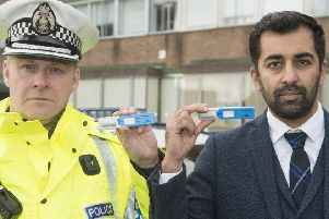 Chief Superintendent Stewart Carle and Justice Secretary Humza Yousaf, holding Drugswipe testing kits, have welcomed the new laws.  (Photo: Neil Hanna)