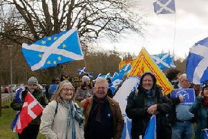 A recent protest in Scotland against Brexit, with the Scotland flag and the EU stars in the background