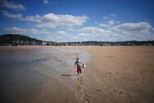Four-year-old Tom enjoys the wide-open spaces on the beach at Houlgate.