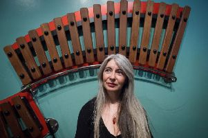 Edinburgh UK Mar 29 2016;  Dame Evelyn Glennie at the National Museum of Scotland for the Edinburgh International Science Festival plays on Huge xylophone and pipes. . credit steven scott taylor / J P License