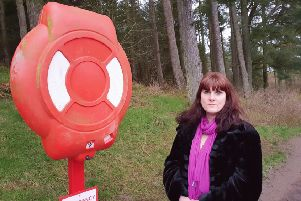 Councillor Marrs with lifebelts at Lanark Loch