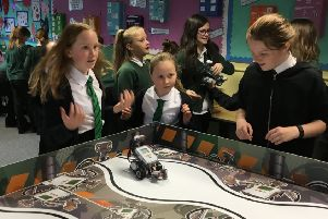 Rising to the challenge...P4-P7 pupils at Springfield Primary School in Linlithgow master the Mindstorms Challenge.