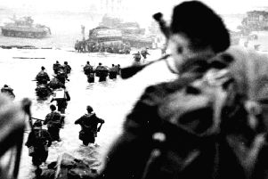 Troops storming the beachhead in 1944