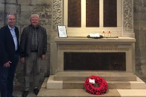 Fitting tribute...Brian Lightbody and Jim Rae at the now fully restored war memorial in St Michael's Parish Church.