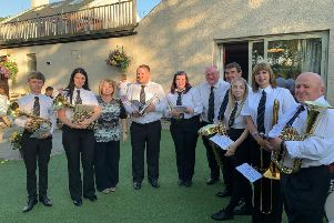Kinneil Band has carried on playing this summer despite a fire sweeping through their band hall in June. Here they are pictured at the Corbie Inn this summer,  where members picked up a cheque from the Bo'ness Real Ale Society.