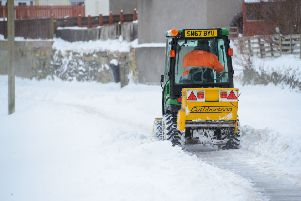 Council gritter clears the paths in Peebles. Scottish Borders Council chiefs want to cut early-morning clearances, a move some councillors are against.
